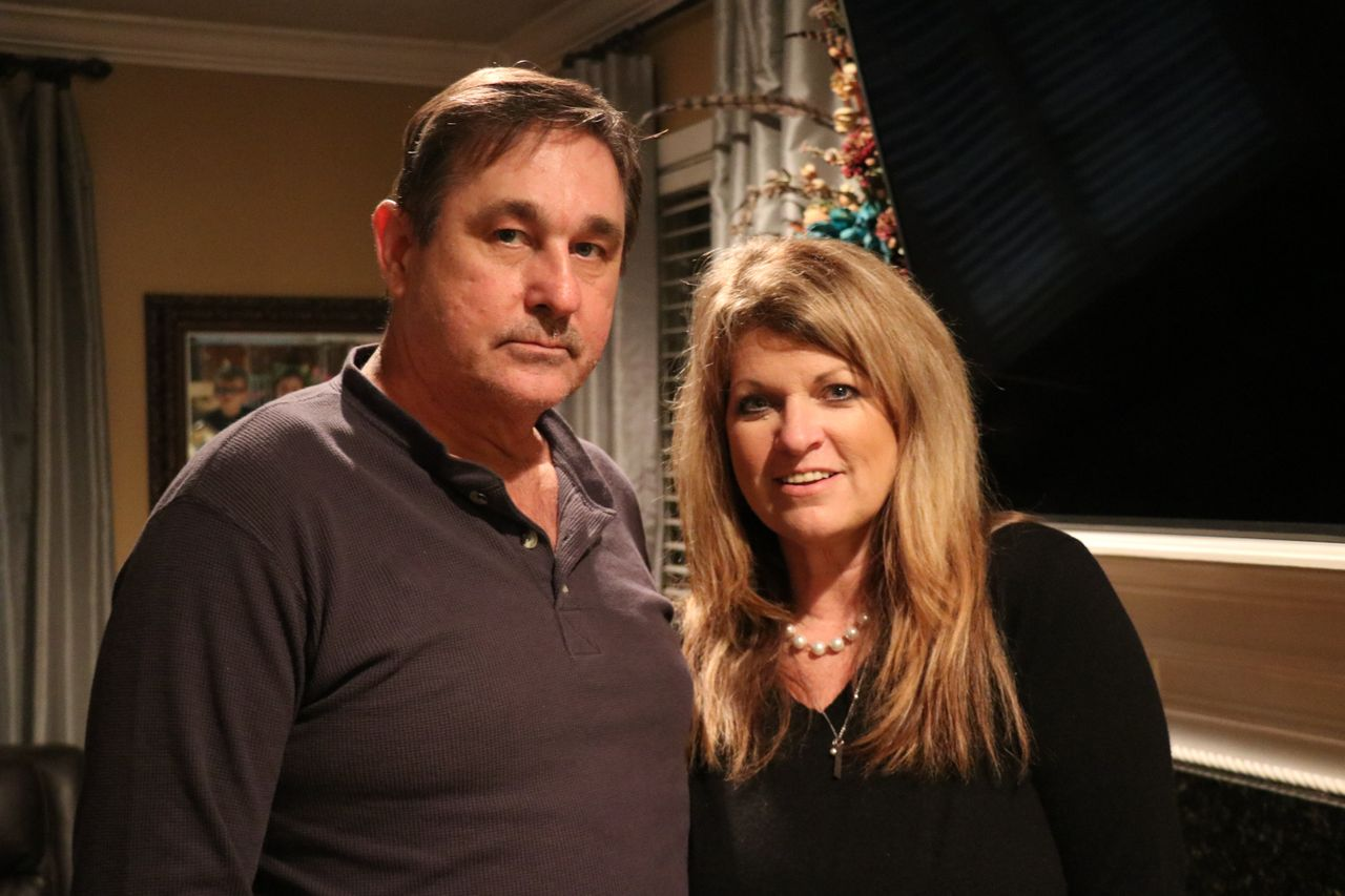 Rocky Meadows with his wife, Becky, in their home in Ocean Springs, Mississippi.