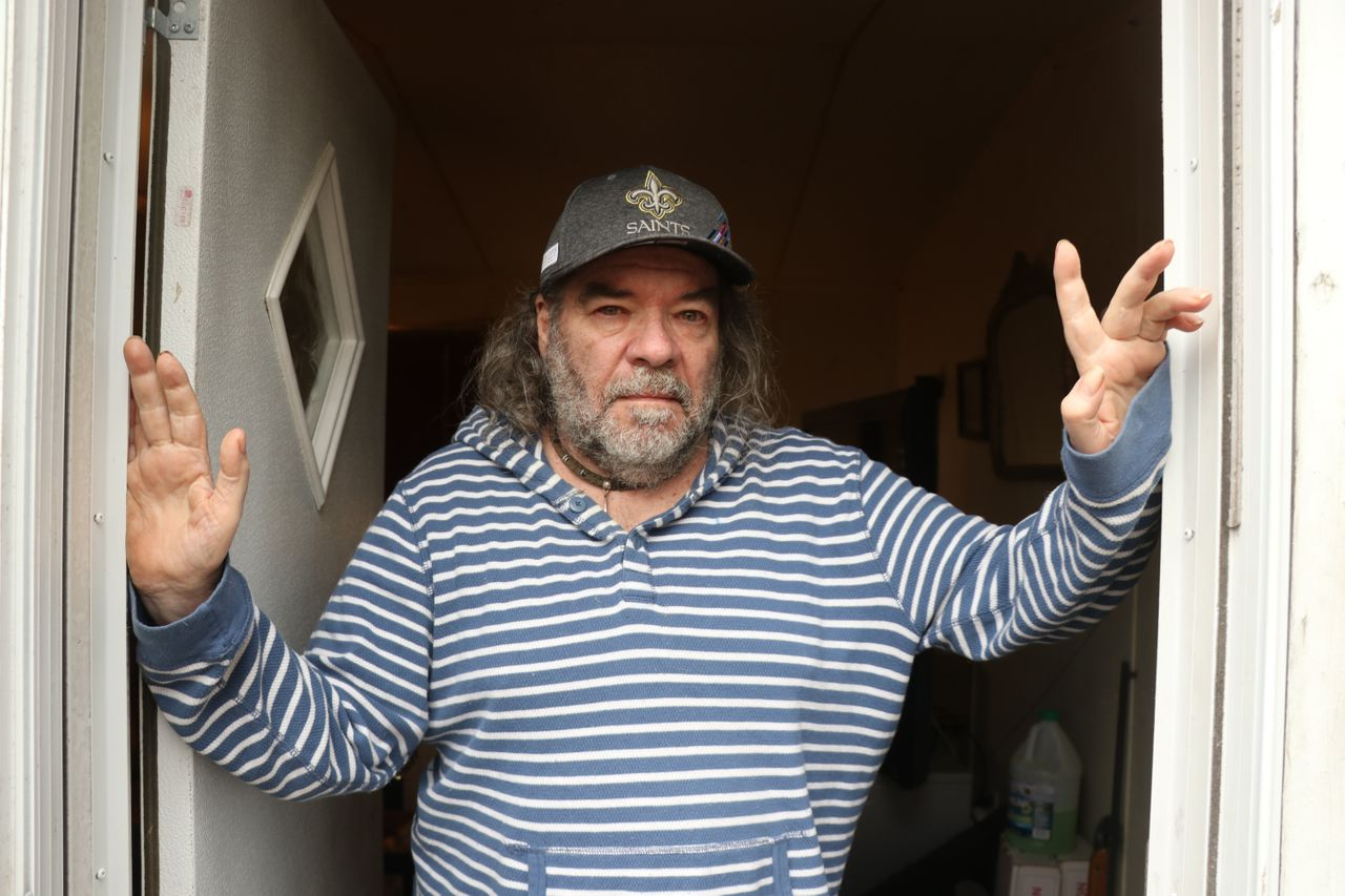 Rick DuFour outside his trailer home that he shares with his 86-year-old father in Moss Point, Mississippi.