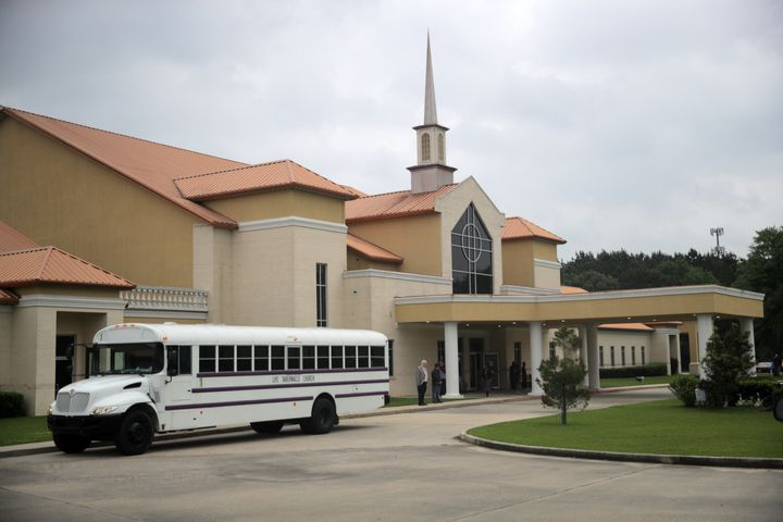 Busloads of congregants arrive at Life Tabernacle Church before Easter services on April 12, 2020.