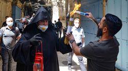 Η τελετή αφής του Αγίου Φωτός στα Ιεροσόλυμα εν μέσω πανδημίας - Φωτογραφίες και
