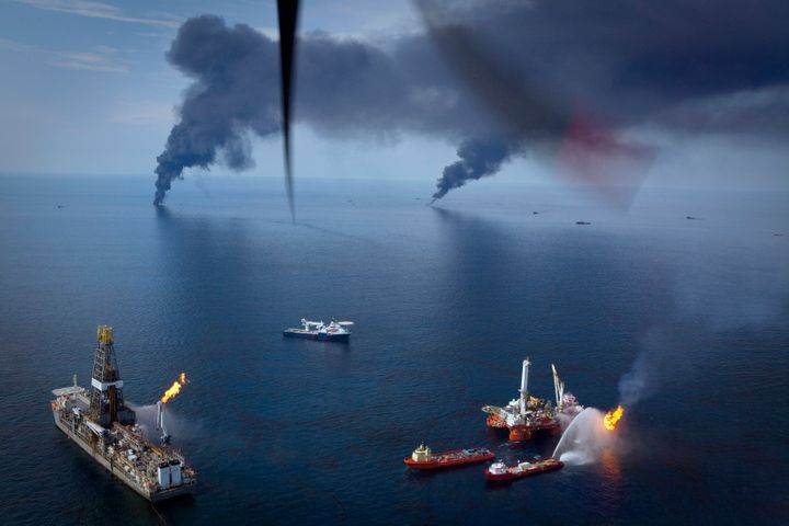 Oil is burned off the surface of the water near the source of the Deepwater Horizon spill in the Gulf of Mexico on June 19, 2010.
