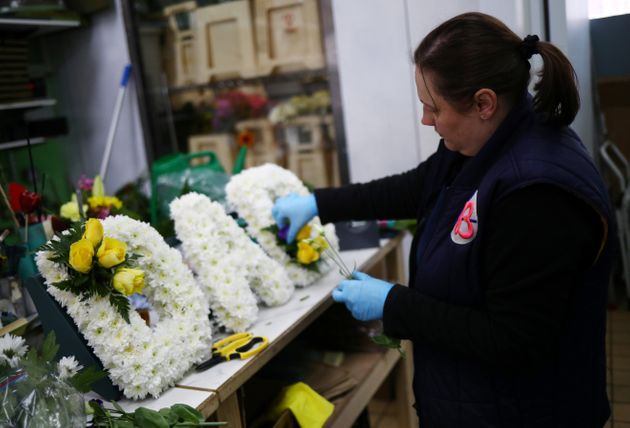 Florist Emma Glynn making a funeral tribute in Barbican as the spread of coronavirus disease (COVID-19) continues in London, Britain, April 15, 2020.