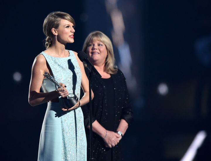 Taylor Swift and her mother Andrea Swift onstage during the 50th Academy Of Country Music Awards.