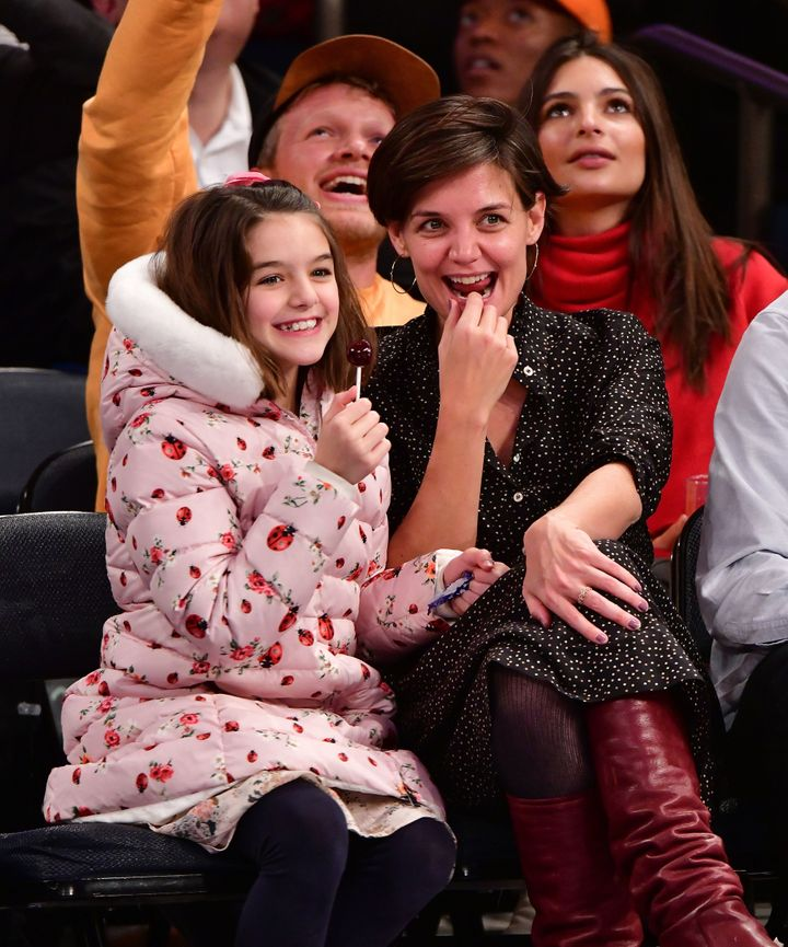 Suri Cruise and Katie Holmes attend an NBA game in 2017.