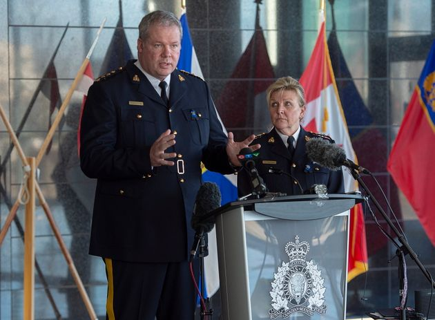 RCMP Chief Supt. Chris Leather, left, and N.S. RCMP Commanding Officer Lee Bergerman field question at a news conference at RCMP headquarters in Dartmouth, N.S. on April 19, 2020.