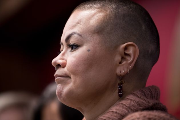 Delee Alexis Nikal, of the Wet'suwet'en Gidimt'en clan, listens during a news conference in Vancouver...
