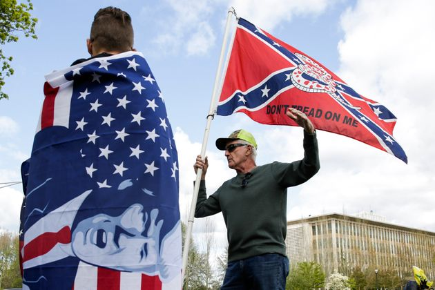 Keith Weber of Centralia, Washington holds a flag that combines a Gadsden flag from the American Revolution...