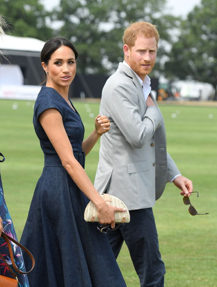 The Sussexes attend the Sentebale ISPS Handa Polo Cup at the Royal County of Berkshire Polo Club on July 26, 2018 in Windsor.