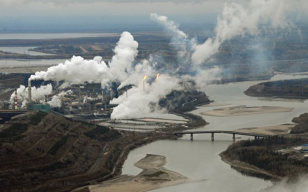 This file photo shows an aerial view of the Suncor oil sands extraction facility on the Athabasca River...