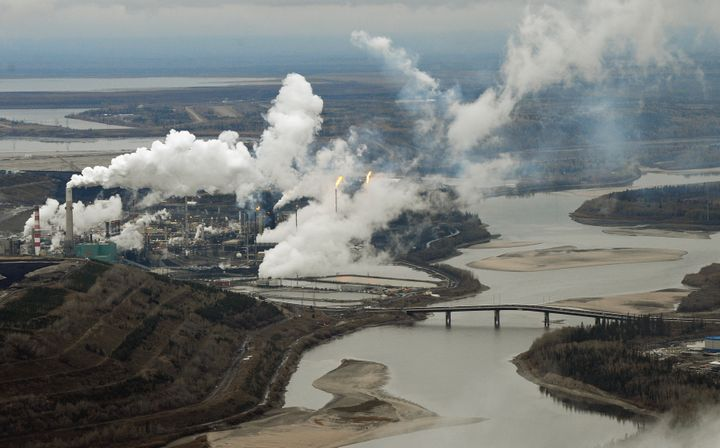 This file photo shows an aerial view of the Suncor oil sands extraction facility on the Athabasca River near Fort McMurray, Alta., Oct. 23, 2009. Canadian oil prices have turned negative amid yet another major decline in global oil prices amid the COVID-19 pandemic.