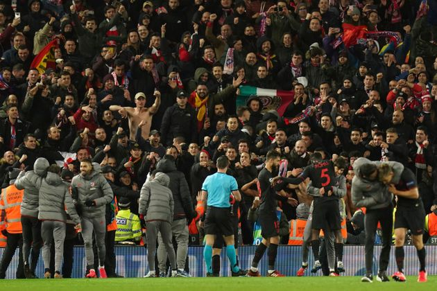 Atletico Madrid players celebrate with fans at the end of the match against Liverpool on March
