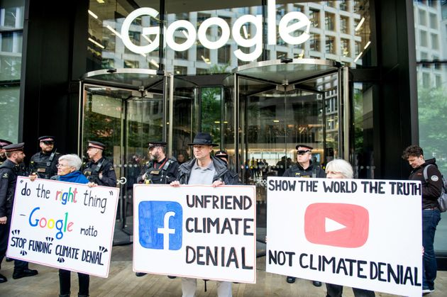 Extinction Rebellion protesters outside Google in London demand that the company stop climate deniers...