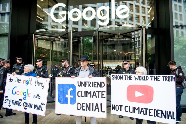 Extinction Rebellion protesters outside Google in London demand that the company stop climate deniers profiting on its platfo