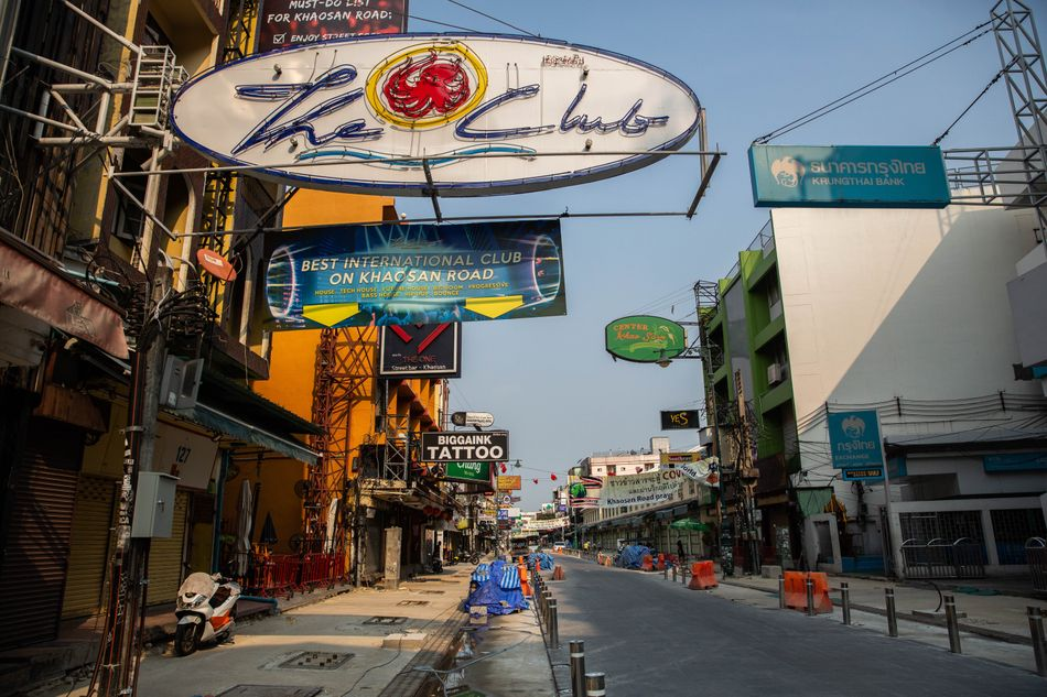 A view of empty streets, shuttered bars, and closed restaurants on Khaosan Road on April 15, 2020 in Bangkok. April 13-15 marks Songkran, Thailand's Buddhist new year celebration, when Thai peopletypically travel to the provinces to be with family or take part in large-scale water fights and parties throughout Bangkok.