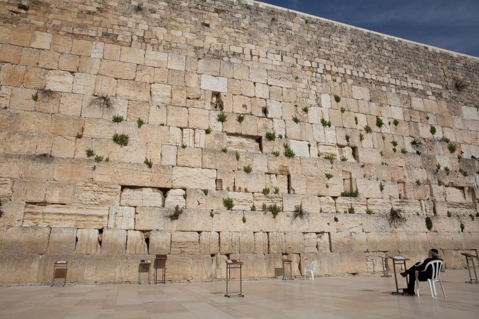 A man prays at the nearly empty Western Wall in the old city on April 6, 2020, in Jerusalem.