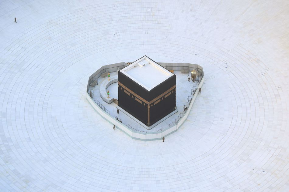 An aerial view shows an empty white-tiled area surrounding the Kaaba in Mecca's Grand Mosque on March 6, 2020.