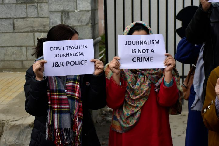 Kashmiri journalists hold placards during a protest in Kashmir on 18 December 2019.
