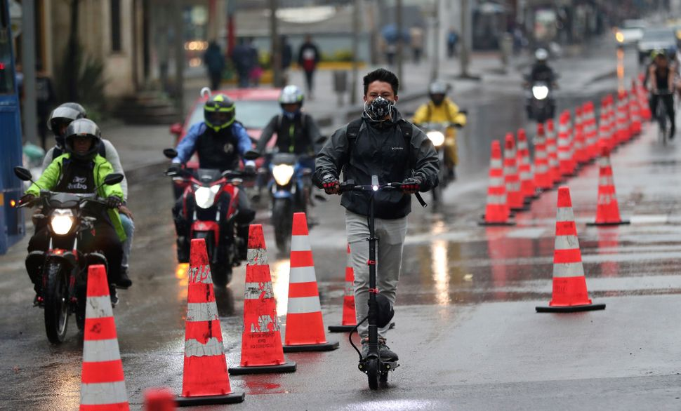 A man riding an electric scooter in a bike lane in Bogotá, Colombia, on March 16, 2020. Officials in the city have exp