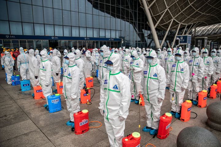 Workers prepare to spray disinfectant at the Wuhan Railway Station in Wuhan, China on March 24, 2020. The city in central China is where the coronavirus first emerged late last year.