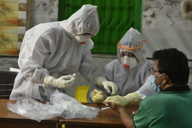 A medical worker takes a sample for antibody test on April 20, 2020 in