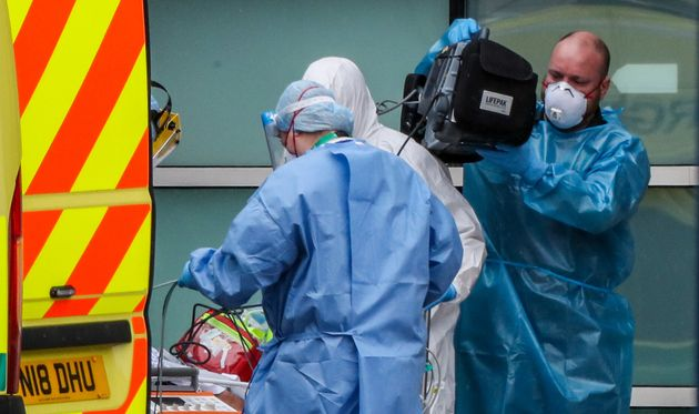 Paramedics and staff at the Royal Liverpool University Hospital wearing items of PPE as the UK continues...