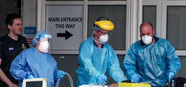 Paramedics and staff at the Royal Liverpool University Hospital wearing various items of