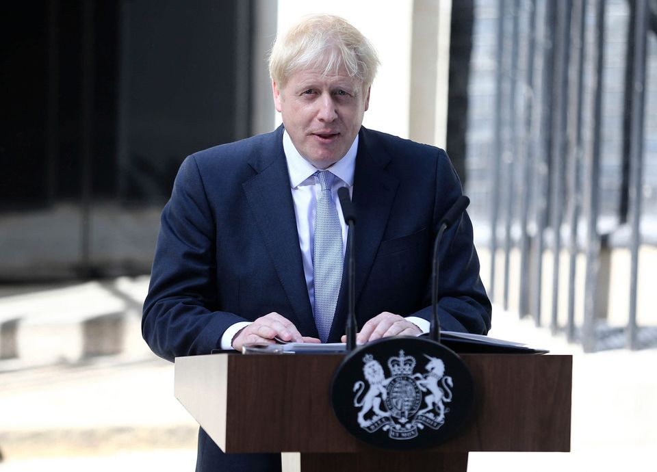 Boris Johnson outside Number 10 before he was diagnosed with