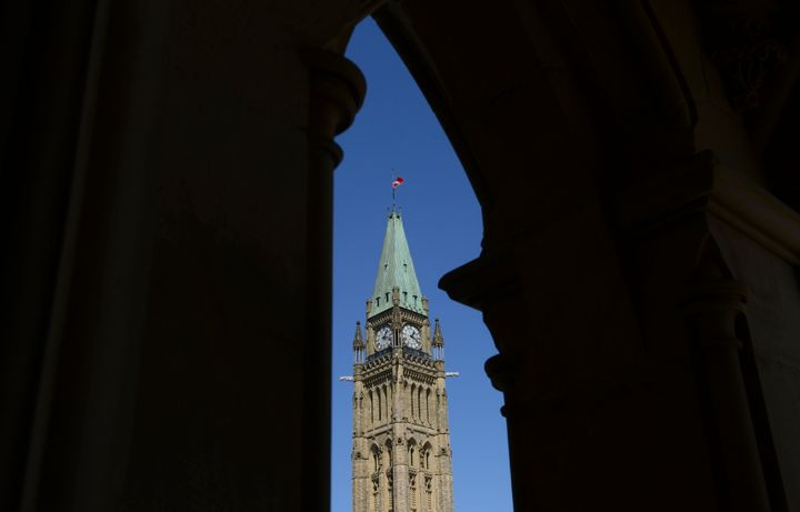 The Canada flag on the Peace Tower on Parliament Hill in Ottawa flies at half mast on April 20, 2020.