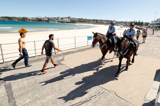 Police officers ride horses as they patrol during a partial lockdown imposed due to the coronavirus in...
