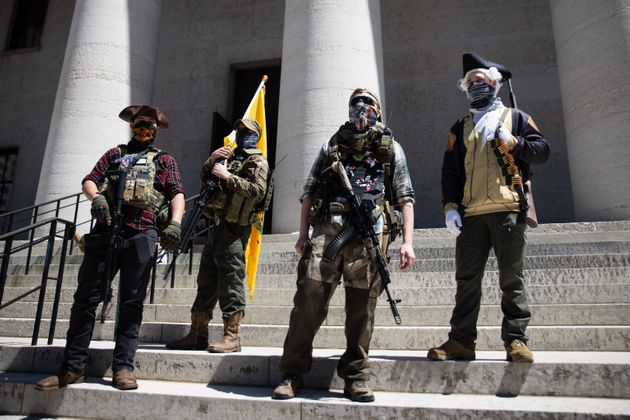 A local militia group is seen at a rally to protest the stay-at-home order amid the Coronavirus pandemic...