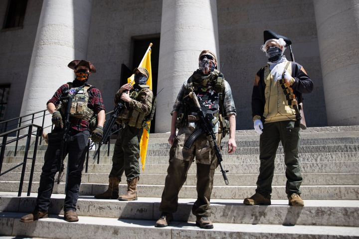 A local militia group is seen at a rally to protest the stay-at-home order amid the Coronavirus pandemic in Columbus, Ohio, o