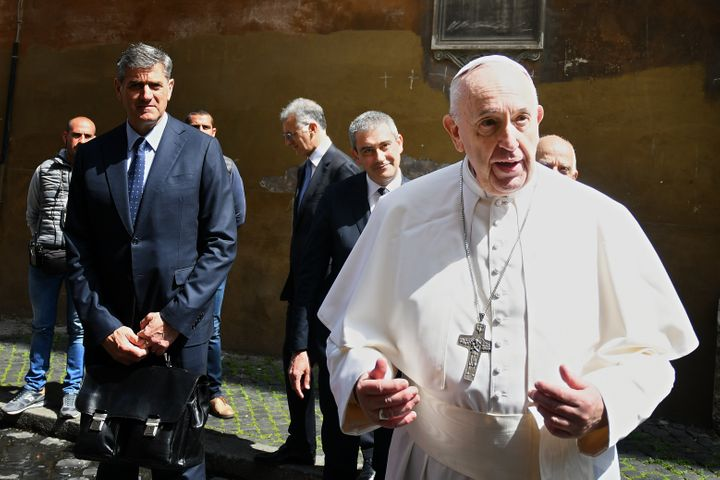 Pope Francis talks to the media after he celebrated Mass behind the closed doors of theSanto Spirito in Sassia church i