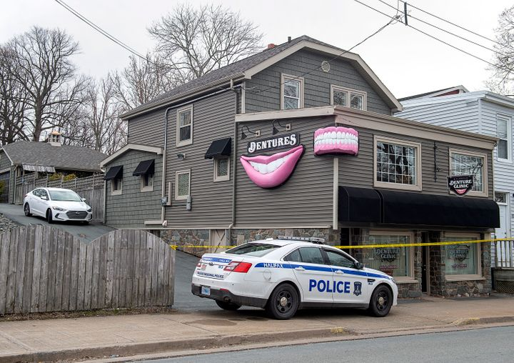 The Atlantic Denture Clinic, owned by Gabriel Wortman, is guarded by police in Dartmouth, Nova Scotia, on Monday, April 20, 2