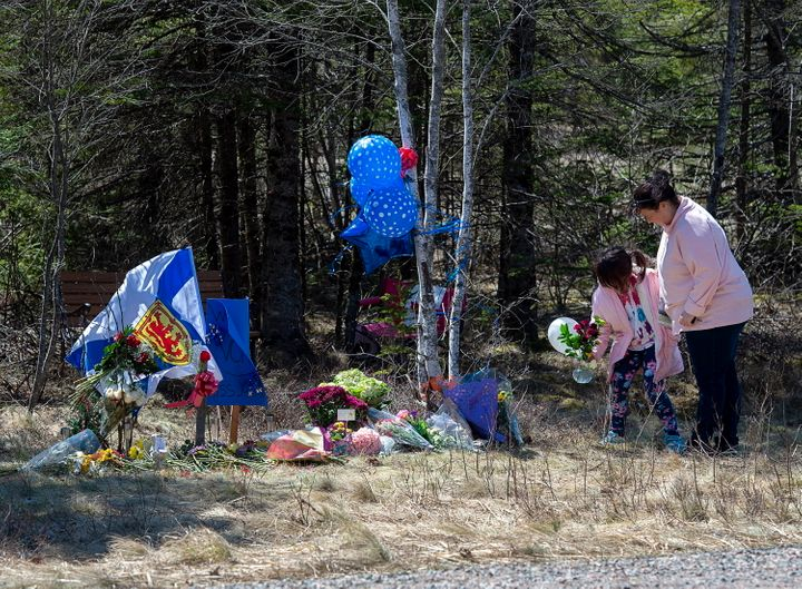 A memorial pays tribute to Heather O'Brien, a victim of this past weekend shootings along the highway in Debert, Nova S