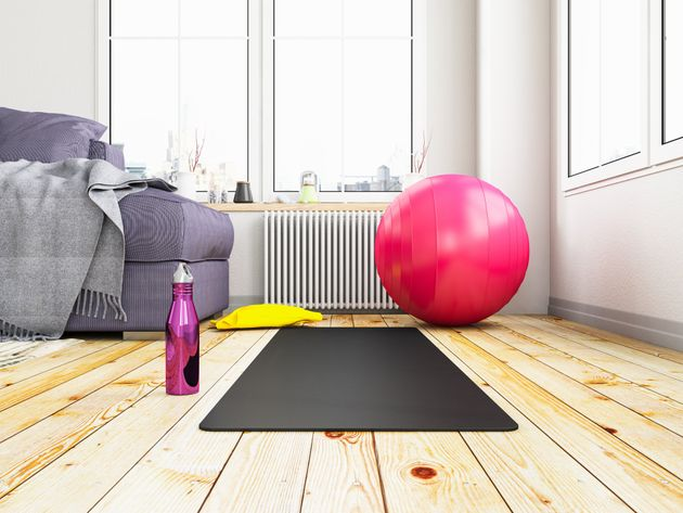 Exercising at Home Concept With Yoga Mat and Pilates Ball. 3d