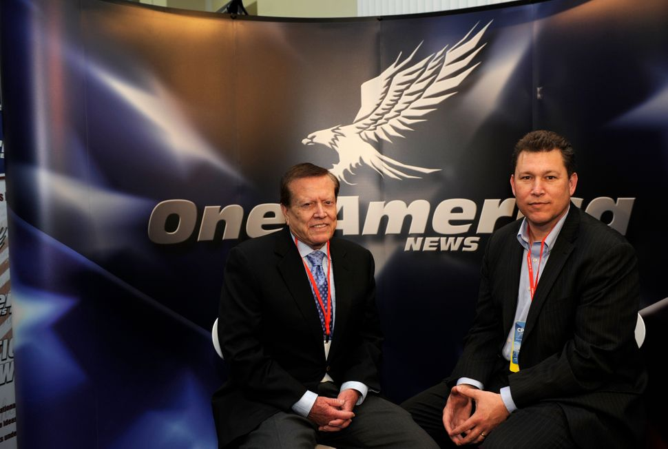 Robert Herring, left, and Charles Herring, right, founders of One America, at the Conservative Political Action Conference on