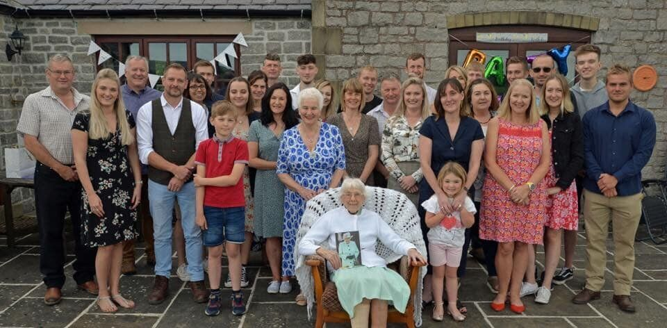 Joan Cavanagh with her family at her 100th birthday party