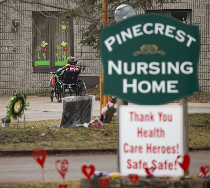 A resident of Pinecrest Nursing Home in Bobcaygeon, Ont. gets some fresh air outside the home, which has become a hotspot for COVID-19.