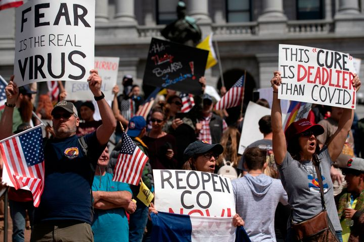 """Demonstrators gather in front of the Colorado State Capitol building to protest coronavirus stay-at-home orders during a """"ReO"""