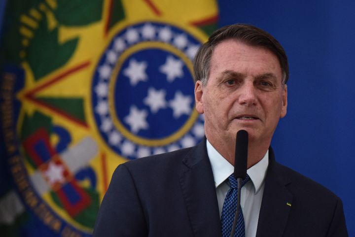 Brazilian President Jair Bolsonaro speaks during the swearing-in ceremony of his new health minister, Nelson Teich, at Planal