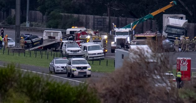 Police and emergency services continue to work at the crash site, which saw four police officers killed,...
