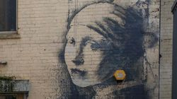 Iconic Banksy Mural Gets A Coronavirus-Themed