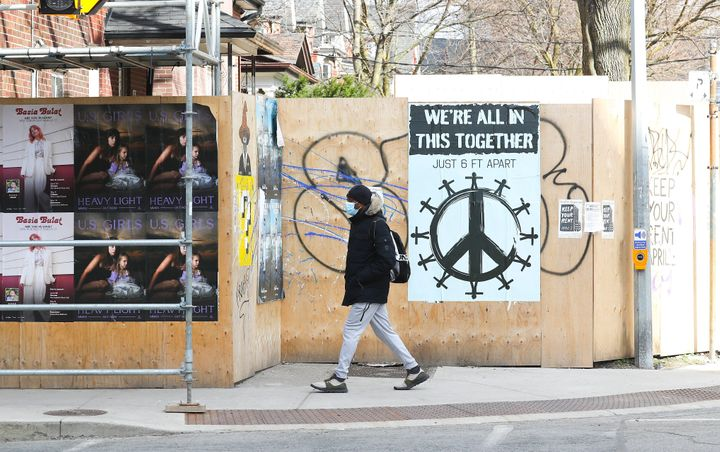 "A ""We're all in this together"" sign in Toronto's Parkdale neighbourhood, where some residents are taking part in a rent strike amid the COVID-19 pandemic."