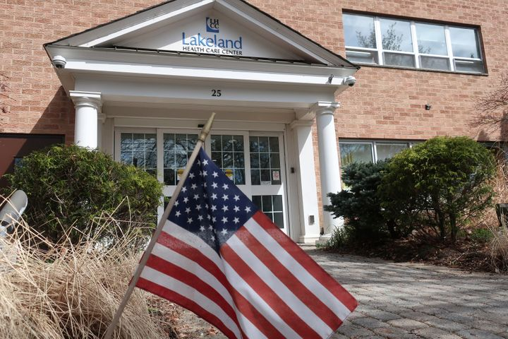 This Wednesday, April 1, 2020, file photo, shows an entrance to the Lakeland Health Care Center, a nursing home in Wanaque, N