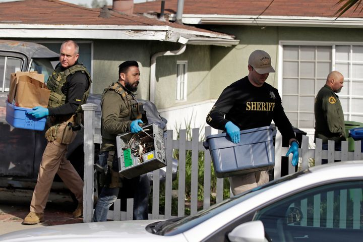 Los Angeles County Sheriff's investigators remove items from a home they searched in February in connection with the Kristin