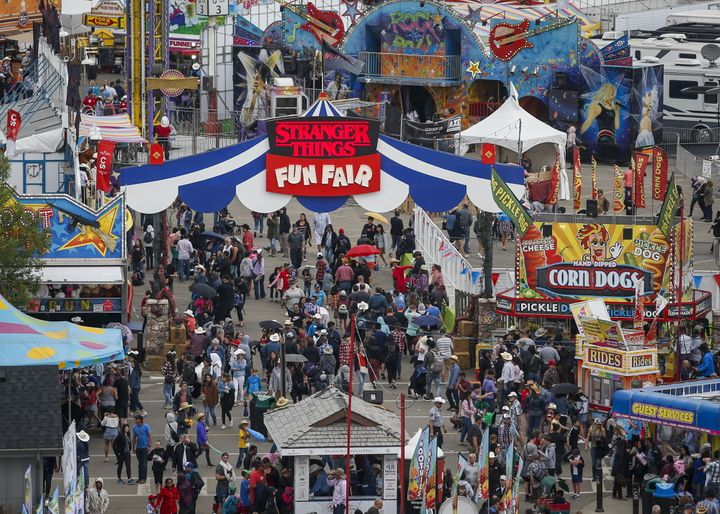 Crowds flock to the midway at the Calgary Stampede in Calgary on July 7, 2019. The Calgary Stampede has been cancelled this year because of COVID-19.