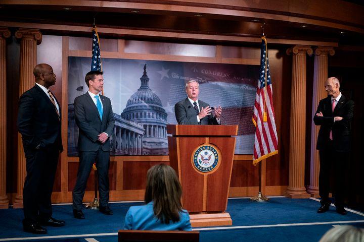 Sen. Lindsey Graham (R-S.C.) speaks while flanked by Sens. Tim Scott (R-S.C.), Ben Sasse (R-Neb.) and Rick Scott (R-Fla.) dur