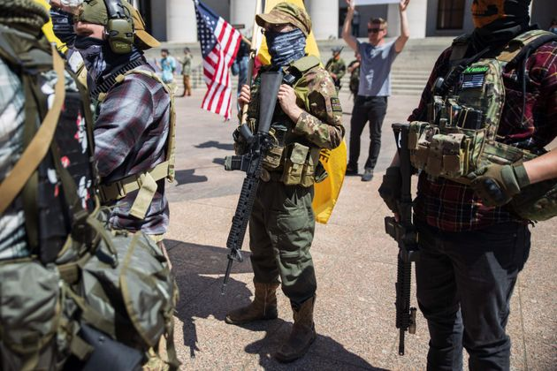 A local militia group is seen at a rally to protest a stay-at-home order in Columbus, Ohio, on April...