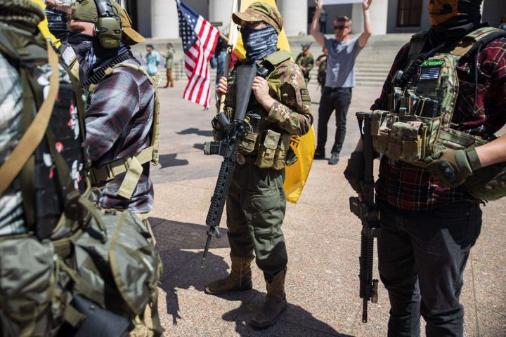 A local militia group is seen at a rally to protest a stay-at-home order in Columbus, Ohio, on April 20. The man in the cente