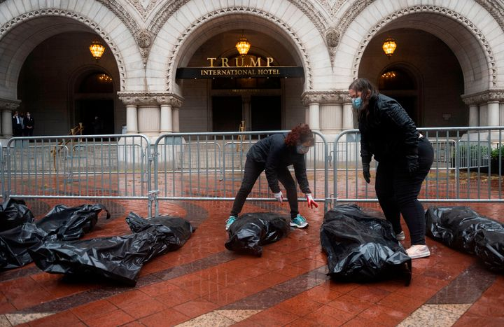 Protesters stop at the Trump International Hotel to deliver fake body bags in Washington, D.C., on April 23, 2020.